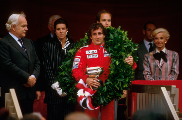 Monte Carlo, Monaco.15-19 May 1985.Alain Prost (McLaren TAG Porsche) 1st position on the podium, with HSH Prince Rainier, Princess Caroline and Prince Albert behind.Ref-85 MON 05.World Copyright - LAT Photographic