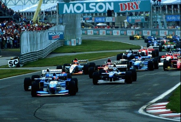 1995 Canadian Grand Prix.Montreal, Quebec, Canada.9-11 June 1995.Michael Schumacher (Benetton B195 Renault) leads at the start.World Copyright - LAT Photographic