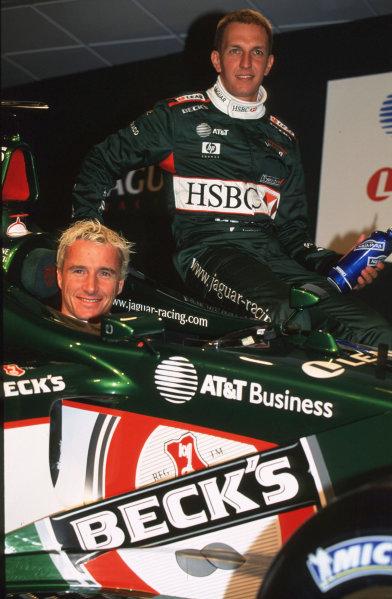 Silverstone, England.10 January 2001.Luciano Burti and Eddie Irvine, Jaguar R2 test.Ref-35mm Image A04.World Copyright - Coates/LAT Photographic