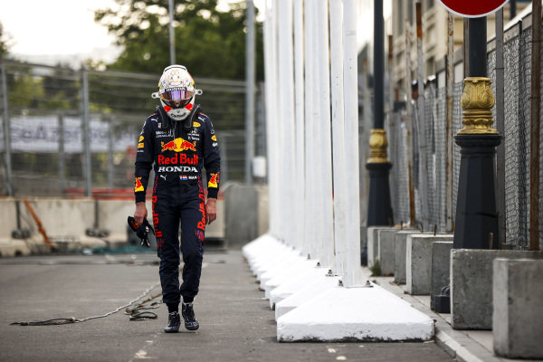Max Verstappen, Red Bull Racing walking with his head down after retiring from the race