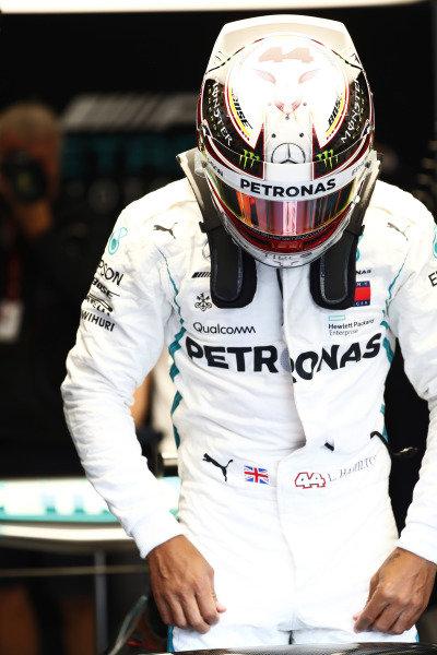Lewis Hamilton, Mercedes AMG F1, enters his cockpit.