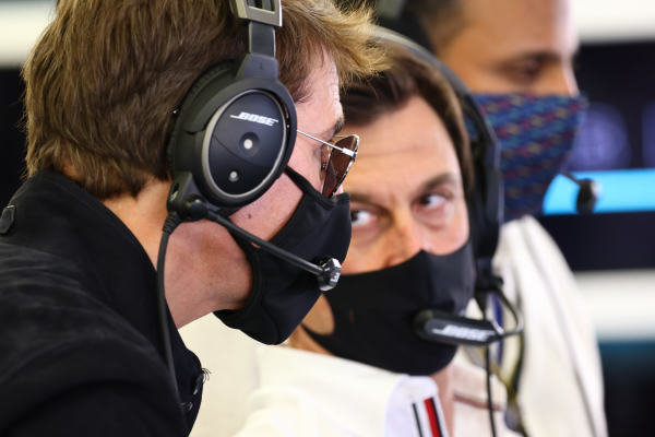 Actor Tom Cruise talks to Toto Wolff, Team Principal and CEO, Mercedes AMG, in the team's garage