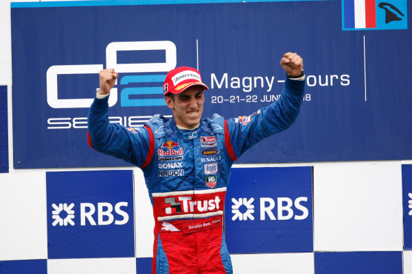 Magny-Cours, France. 22nd June.Sunday Race. Sebastien Buemi (SUI, Trust Team Arden) celebrates victory on the podium. World Copyright: Andrew Ferraro/GP2 Series Media Service.ref: Digital Image _H0Y8050
