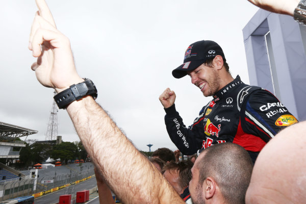 Interlagos, Sao Paulo, Brazil. Sunday 25th November 2012. Sebastian Vettel, Red Bull Racing, 2012 F1 World Champion, celebrates with his team. World Copyright:Andy Hone/LAT Photographic ref: Digital Image HONZ3905