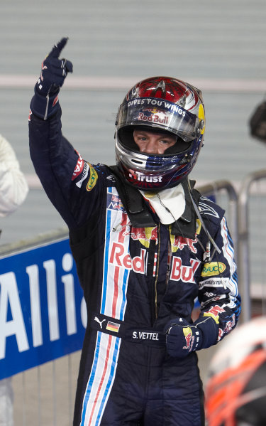 Yas Marina Circuit, Abu Dhabi, United Arab Emirates 1st November 2009. Sebastian Vettel, Red Bull Racing RB5 Renault, 1st position, and celebrates in Parc Ferme. Portrait. Helmets. Finish. World Copyright: Steve Etherington/LAT Photographic ref: Digital Image SNE17903