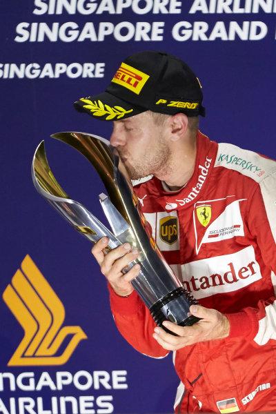 Marina Bay Circuit, Singapore. Sunday 20 September 2015. Sebastian Vettel, Ferrari, 1st Position, kisses his trophy. World Copyright: Steve Etherington/LAT Photographic ref: Digital Image SNE29649