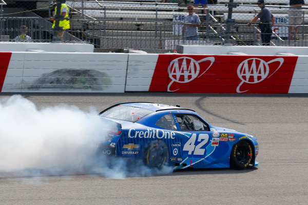 NASCAR Xfinity Series ToyotaCare 250 Richmond International Raceway, Richmond, VA USA Saturday 29 April 2017 Kyle Larson, Credit One Bank Chevrolet Camaro celebrates his win with a burnout World Copyright: Russell LaBounty LAT Images ref: Digital Image 17RIC1Jrl_4705