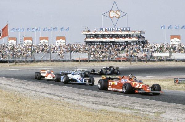 1981 Spanish Grand Prix.Jarama, Spain. 19-21 June 1981.Gilles Villeneuve (Ferrari 126CK) leads Jacques Laffite (Ligier JS17-Matra), John Watson (McLaren MP4/1-Ford Cosworth), Carlos Reutemann (Williams FW07C-Ford Cosworth) and Elio de Angelis (Lotus 87-Ford Cosworth).World Copyright: LAT PhotographicRef: 35mm transparency 81ESP09