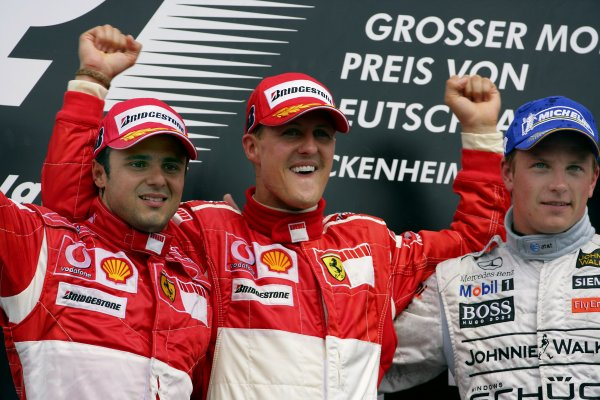 2006 German Grand Prix - Sunday Race Hockenheim, Germany. 27th - 30th July. Michael Schumacher (1st position), and Felipe Massa (2nd position) of Ferrari celebrate on the podium with Kimi Raikkonen (3rd position) of McLaren-Mercedes. World Copyright: Lorenzo Bellanca/LAT Photographic ref: Digital Image ZD2J2137