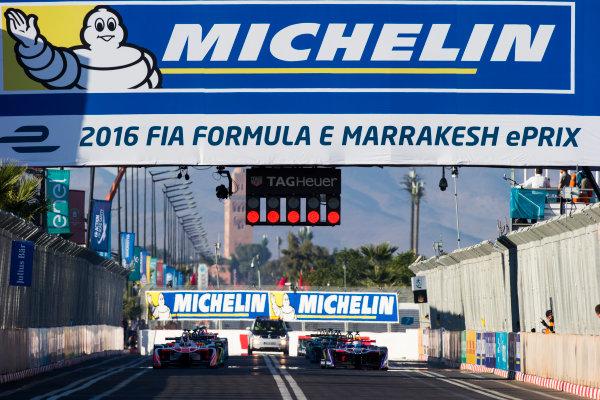 2016/2017 FIA Formula E Championship. Marrakesh ePrix, Circuit International Automobile Moulay El Hassan, Marrakesh, Morocco. Felix Rosenqvist (SWE), Mahindra Racing, Spark-Mahindra, Mahindra M3ELECTRO & Sam Bird (GBR), DS Virgin Racing, Spark-Citroen, Virgin DSV-02. line up at the front of the grid Saturday 12 November 2016. Photo: Sam Bloxham/LAT/Formula E ref: Digital Image _SLA8131