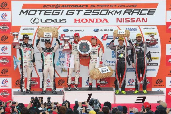 2015 Japanese Super GT Series. Motegi, Japan. 14th - 15th November 2015. Rd 8. GT300 Winner Koki Saga & Yuichi Nakayama ( #31 TOYOTA PRIUS apr GT ) 2nd position Nobuteru Taniguchi & Tatsuya Kataoka ( #0 GOODSMILE HATSUNE MIKU SLS ) 3rd position Katsuyuki Hiranaka & Bjorn Wirdheim ( #11 GAINER TANAX SLS ) podium, portrait. World Copyright: Yasushi Ishihara / LAT Photographic. Ref: 2015SGT_Rd8_020