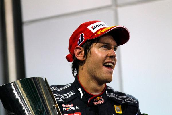 Yas Marina Circuit, Abu Dhabi, United Arab Emirates14th November 2010.Sebastian Vettel, Red Bull Racing RB6 Renault, 1st position, with his trophy. Portrait. Podium. World Steven Tee/LAT Photographic ref: Digital Image _A8C7920