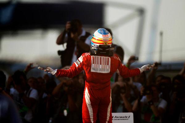 Bahrain International Circuit, Sakhir, Bahrain 14th March 2010 Fernando Alonso, Ferrari F10, 1st position, celebrates victory. Portrait. Helmets. Finish. World Copyright: Andrew Ferraro /LAT Photographic ref: Digital Image _Q0C5655