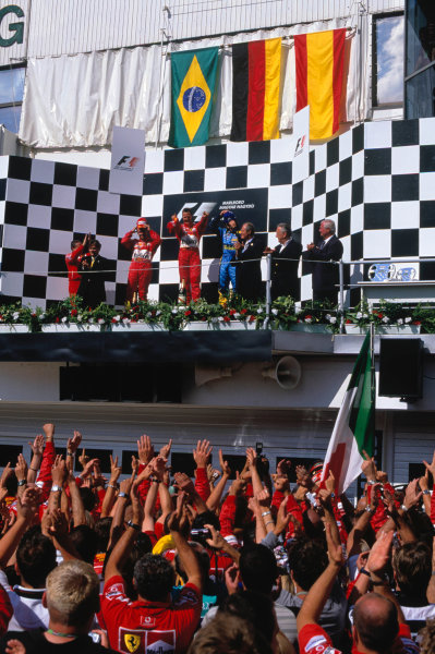2004 Hungarian Grand Prix Hungaroring, Hungary. 13th - 15th August. The Ferrari team celebrate as the drivers stand on the podium.World Copyright:Michael Cooper/LAT Photographic Ref:35mm Image:A20