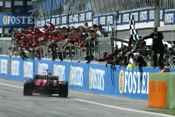 2004 San Marino Grand Prix - Sunday Race, 2004 San Marino Grand Prix  Imola, Italy. 25th April 2004. Michael Schumacher crosses the line to record his 4th win of 2004 in front of his beloved Tifosi.  World Copyright: Steve Etherington/LAT Photographic  ref: Digital Image Only