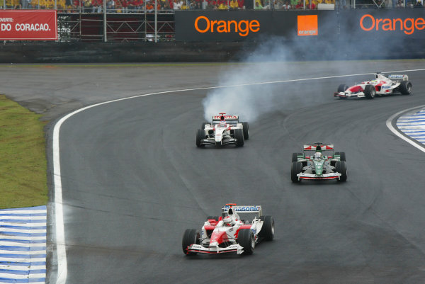 2004 Brazilian Grand Prix-Sunday Race,Sao Paulo, Brazil. 24th October 2004.Jarno Trulli, Toyota TF104 leads Christian Klien, Jaguar R5 and Ricardo Zonta, Toyota TF104 as Jenson Button, BAR Honda 006 blows up and heads for retirement. Action.World Copyright LAT Photographic/Martyn Elford.Digital Image only (a high res version is available on request).