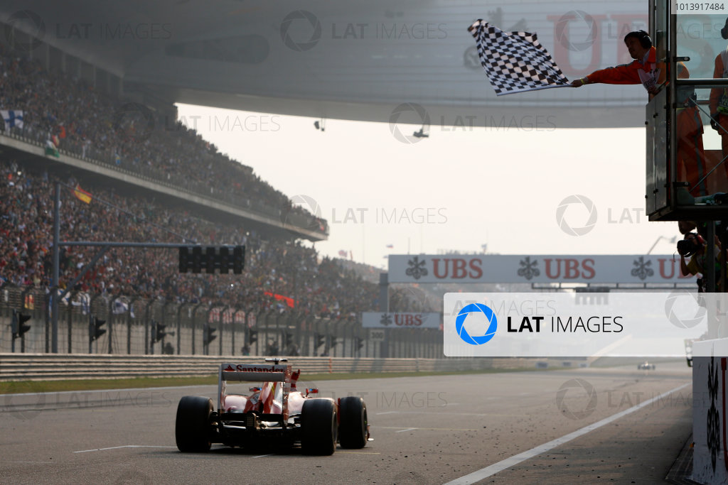Shanghai International Circuit, Shanghai, China Sunday 14th April 2013 Fernando Alonso, Ferrari F138, takes the chequered flag for victory. World Copyright: Alastair Staley/LAT Photographic ref: Digital Image _R6T2290