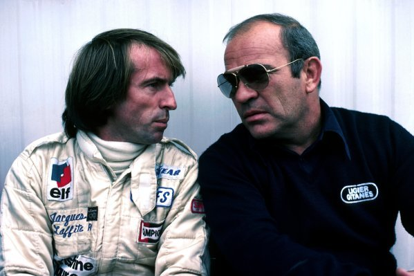 (L to R): Jacques Laffite (FRA) Ligier, who retired from the race on lap 6 with a blown engine, talks with Guy Ligier (FRA) Ligier Team Owner.