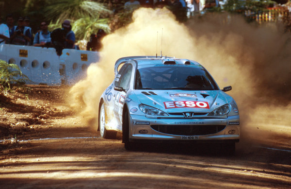 Rally Australia10th-12th November 2000Eventual winners Marcus Gronholm and Timo Rautiainen, Peugeot 206, after Tommi Makinen's disqalification. Action.World Copyright © LAT Photographic