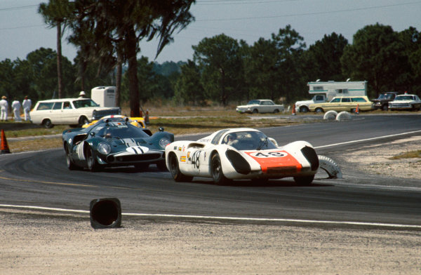 Sebring, Florida, USA. 23rd March 1968.Gerhard Mitter/Rolf Stommelen (Porsche 907 2 2), retired, leads Mike De Udy/Hugh Dibley (Lola T70 Mk 3 Chevrolet), retired, action. World Copyright: LAT Photographic.Ref:  68S/CARS15