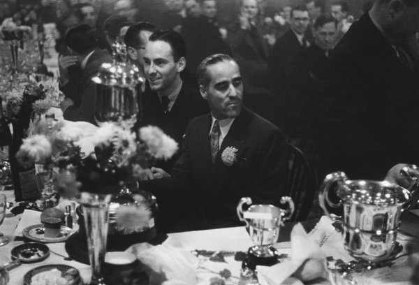 1938 Donington Grand Prix. Donington Park, Great Britain. 22nd October 1938. Tazio Nuvolari and Dick Seaman enjoy the celebrations at the after-race dinner party, portrait.  World Copyright: LAT Photographic. Ref:  L89 - 2.