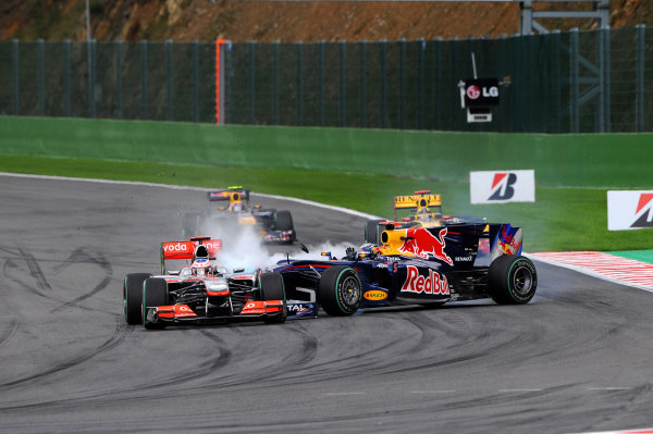 Spa-Francorchamps, Spa, Belgium29th August 2010Sebastian Vettel, Red Bull Racing RB6 Renault, 15th position, gets out of shape during an attempt to pass Jenson Button, McLaren MP4-25 Mercedes, retired, and ends up colliding with him and ending his race. Action. Crashes.World Copyright: Alberto Crippa/LAT Photographicref: Digital Image A1B_7736