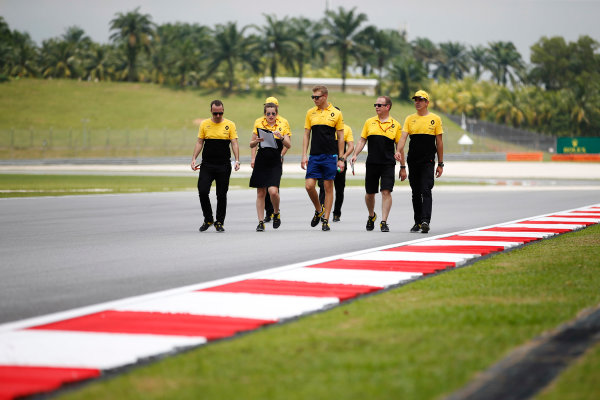 Sepang International Circuit, Sepang, Malaysia. Thursday 28 September 2017. Sergey Sirotkin, test and development driver, Renault, conducts a track walk with colleagues. World Copyright: Zak Mauger/LAT Images  ref: Digital Image _X0W6763
