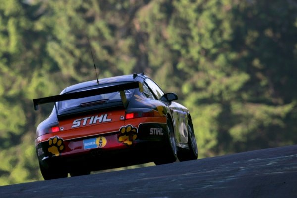 A Porsche heads over the crest. Nurburgring 24 Hour Race, Nurburgring, Germany 17-18 June 2006 DIGITAL IMAGE