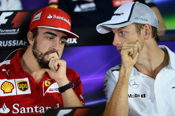 (L to R): Fernando Alonso (ESP) Ferrari and Jenson Button (GBR) McLaren in the Press Conference. Formula One World Championship, Rd16, Russian Grand Prix, Preparations, Sochi Autodrom, Sochi, Krasnodar Krai, Russia, Thursday 9 October 2014.