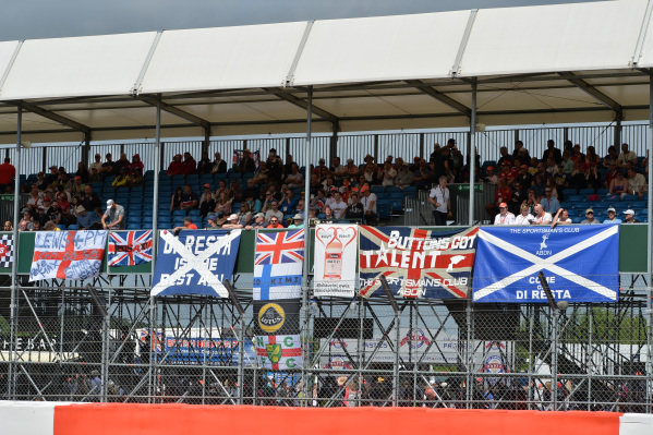 Fans and flags in the grandstand. Formula One World Championship, Rd8, British Grand Prix, Race Day, Silverstone, England, Sunday 30 June 2013.