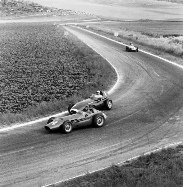 Reims, France. 4th - 6th July 1958.Juan Manuel Fangio (Maserati 250F), 4th position, leads Stirling Moss (Vanwall VW10), 2nd position, action. World Copyright: LAT Photographic.Ref: 2151.