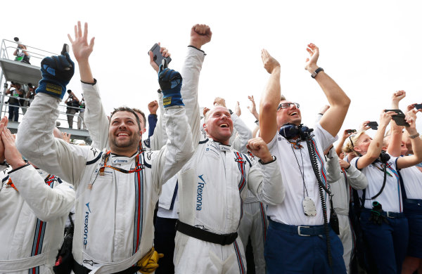 Circuit Gilles Villeneuve, Montreal, Canada. Sunday 7 June 2015. Williams team members applaud Valtteri Bottas, Williams F1, 3rd Position, on the podium. World Copyright: Steven Tee/LAT Photographic. ref: Digital Image _L4R7429
