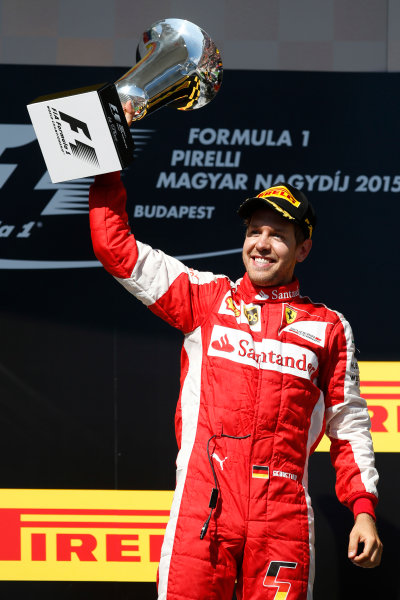 Hungaroring, Budapest, Hungary. Sunday 26 July 2015. Sebastian Vettel, Ferrari, celebrates his win on the podium. World Copyright: Glenn Dunbar/LAT Photographic ref: Digital Image _W2Q1072