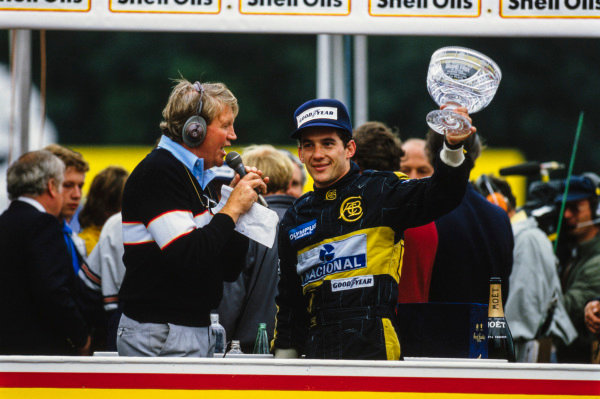 Ayrton Senna celebrates on the podium.
