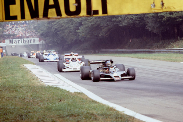1978 Italian Grand PrixMonza, Italy. 10 September 1978.Ronnie Peterson (Lotus 78-Ford) leads Alan Jones (Williams FW06-Ford) and the rest of the field on the race warm-up lap. Peterson suffered fatal injuries in an accident at the first corner of the race. Ref-35mm Image.World Copyright-LAT Photographic