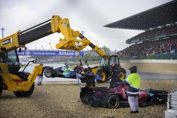 Recovery vehicles work to remove the retired Honda RA107 of Jenson Button and Scott Speed's Toro Rosso STR2 Ferrari.