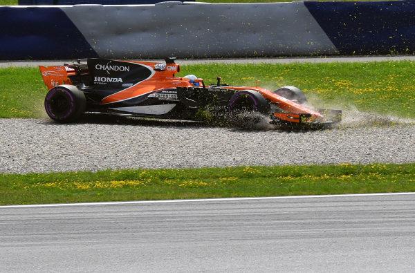 Fernando Alonso (ESP) McLaren MCL32 spins into the gravel at Formula One World Championship, Rd9, Austrian Grand Prix, Practice, Spielberg, Austria, Friday 7 July 2017.