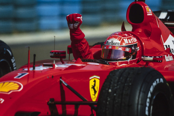 Michael Schumacher, Ferrari F2001, celebrates securing the race victory and clinching the world drivers' championship for a fourth time.