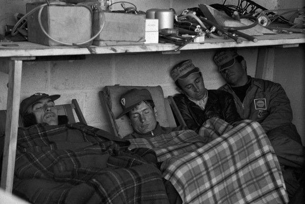 Ferrari mechanics asleep in the garage.