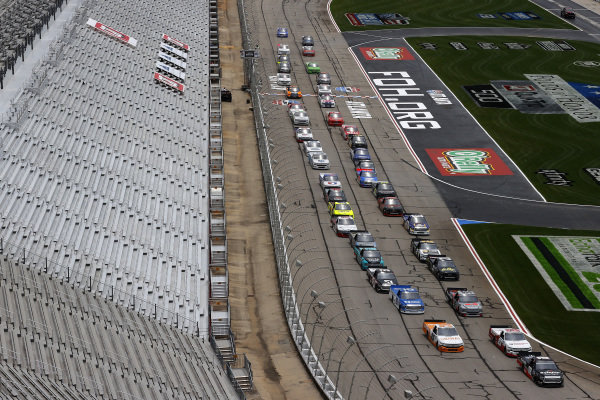 Christian Eckes, Kyle Busch Motorsports Toyota Safelite AutoGlass, leads the field to start, Copyright: Kevin C. Cox/Getty Images.