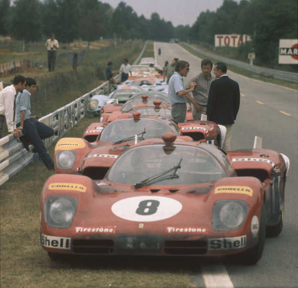 A Ferrari 512S, that in the real race was driven by Arturo Merzario and Clay Regazzoni, is parked in a line of cars during filming for the Steve MCqueen Solar Productions film Le Mans. In the film, the car is driven by Eric Stahler, played by Siefried Rauch