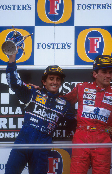 1993 Australian Grand Prix.Adelaide, Australia.5-7 November 1993.Alain Prost (Williams Renault) 2nd position with Ayrton Senna (McLaren Ford) 1st position on the podium. Ref-93 AUS 08.World Copyright - LAT Photographic