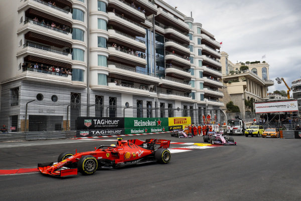 Charles Leclerc, Ferrari SF90, leads Lance Stroll, Racing Point RP19, and Sergio Perez, Racing Point RP19