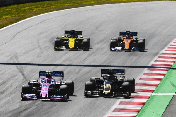 Lance Stroll, Racing Point RP19, leads Kevin Magnussen, Haas VF-19, Daniel Ricciardo, Renault R.S.19, and Carlos Sainz Jr., McLaren MCL34
