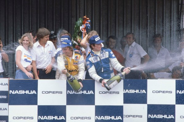 1980 South African Grand Prix.Kyalami, South Africa.28/2-1/3 1980.Rene Arnoux (Equipe Renault) celebrates his 1st position on the podium with Patrick Depailler (Ligier Ford) 3rd position.Ref-80 SA 06.World Copyright - LAT Photographic