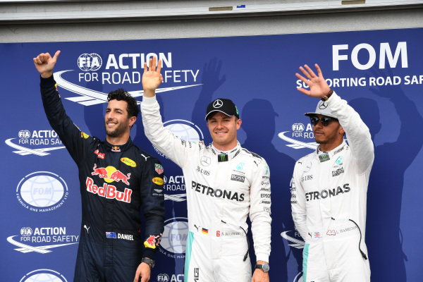 (L to R): Daniel Ricciardo (AUS) Red Bull Racing, pole sitter Nico Rosberg (GER) Mercedes AMG F1 and Lewis Hamilton (GBR) Mercedes AMG F1 celebrate in parc ferme at Formula One World Championship, Rd12, German Grand Prix, Qualifying, Hockenheim, Germany, Saturday 30 July 2016. BEST IMAGE