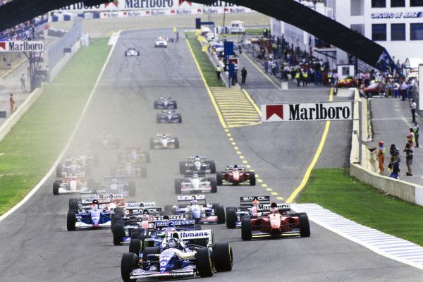 Damon Hill, Williams FW16B Renault, leads Michael Schumacher, Benetton B194 Ford, Heinz-Harald Frentzen, Sauber C13 Mercedes, and Gerhard Berger, Ferrari 412T1B, at the start.