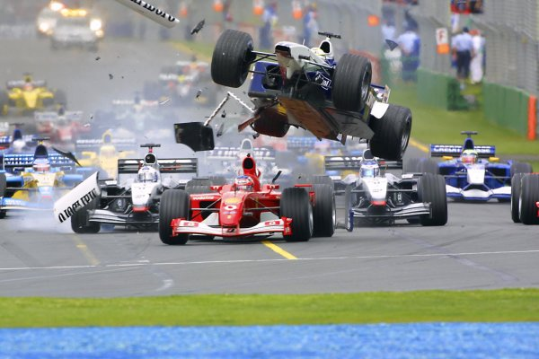 2002 Qantas Australian Grand Prix - Sunday Race. Albert Park, Melbourne. 3rd March 2002. Ralf Schumacher (Williams FW24-BMW) airborn after colliding with Rubens Barrichello (Ferrari F2001) at the first corner. World Copyright - Picme/LAT Photographic ref: Digital Image Only