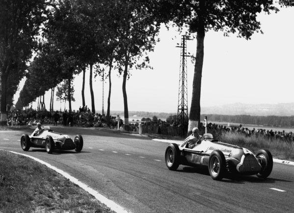 Reims, France. 1950Race winner Juan Manuel Fangio (Alfa Romeo 158/50 8), action.World Copyright: LAT Photographicref: C27340