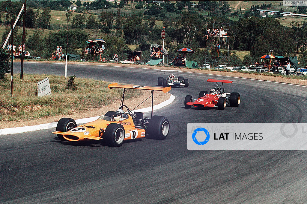 Kyalami, South Africa.27/2-1/3 1969.Bruce McLaren (McLaren M7A Ford) leads Chris Amon (Ferrari 312) and Jo Siffert (Lotus 49 Ford). Siffert and McLaren finished in 4th and 5th positions respectively.Ref-35mm 69 SA 95.World Copyright - LAT Photographic